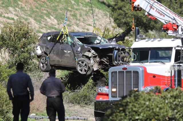Tiger Woods' badly damaged SUV gets towed after rollover crash