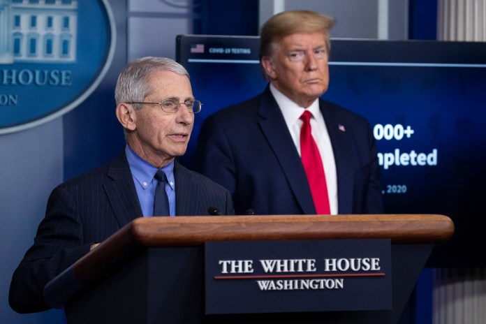 Trump watches as Fauci speaks at a press conference on April 17, 2020