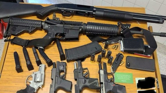 The suspect appeared in court after taking six guns including AR-15 into the store
