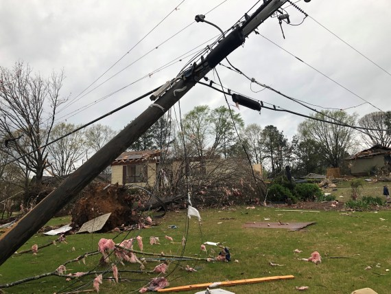 In addition to the deaths, there were downed power lines and trees, and several damaged businesses