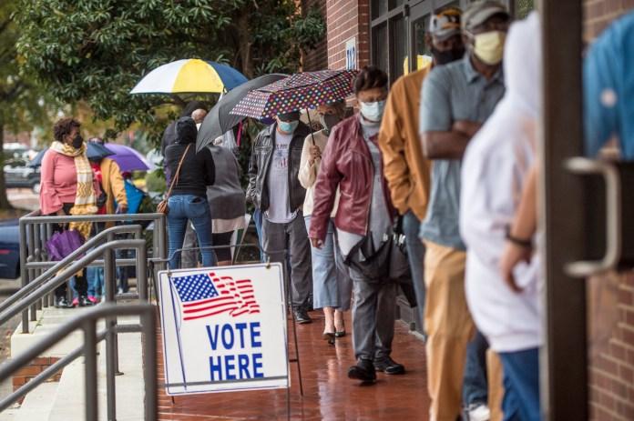 People line up to vote in Georgia's Senate runoff elections in Georgia in December