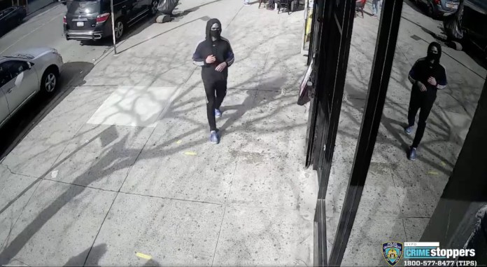 =Footage shows a man casually walking down Audubon Avenue in Washington Heights just after 3:40pm on Friday.