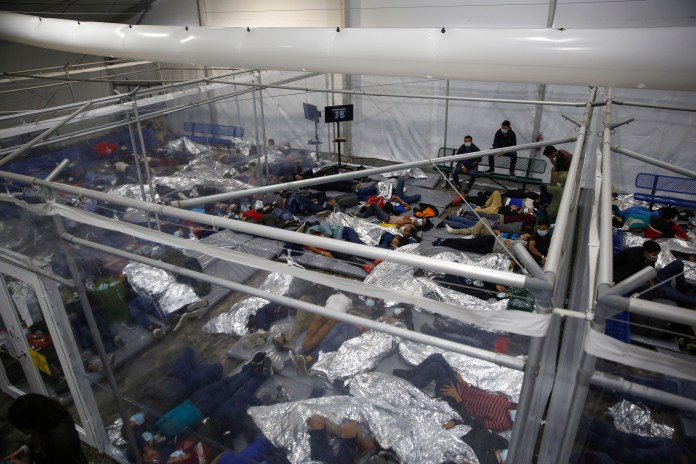 An influx of migrants, including children by themselves, has led to overcrowding at the facilities meant to hold them