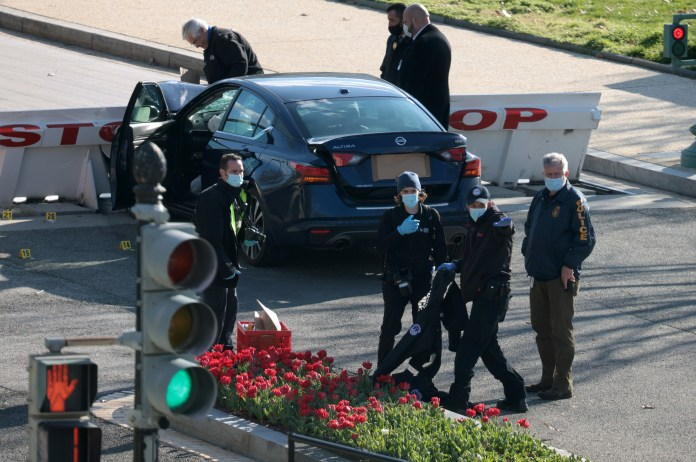 One officer died after the suspect drove a car into him
