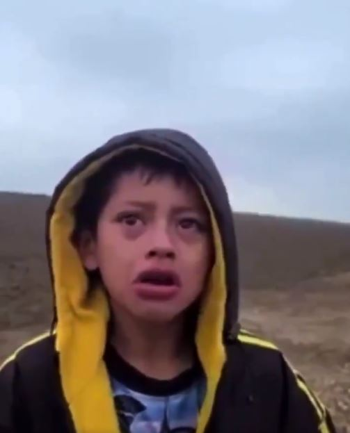Heartbreaking moment crying migrant boy begs border patrol for help after  being abandoned in desert as crisis deepens