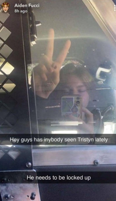 He allegedly posted a Snapchat photograph of himself in the back of a squad car