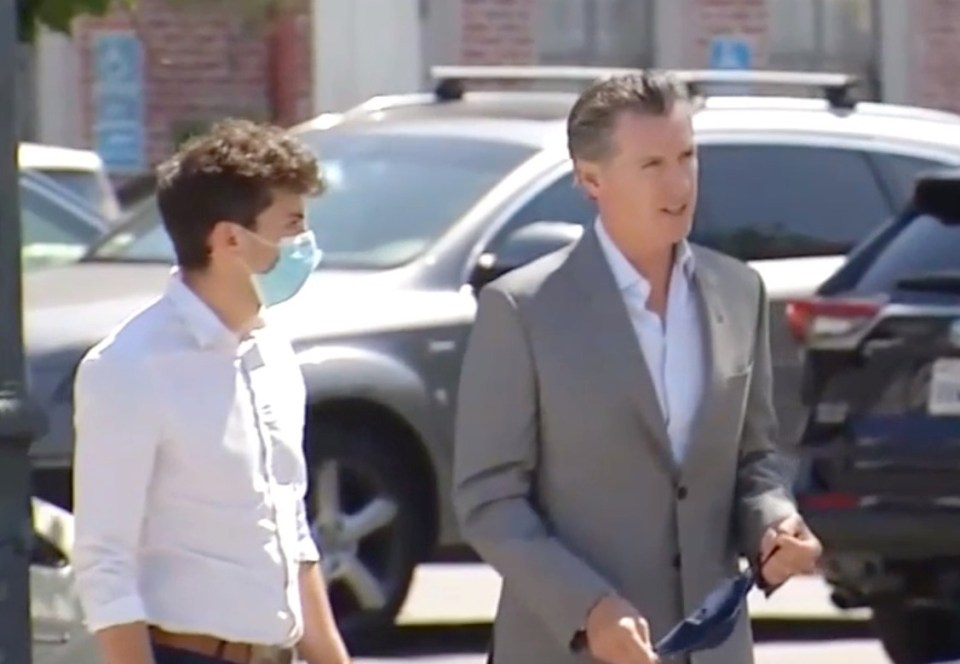 Newsom was seen walking away from the incident undeterred
