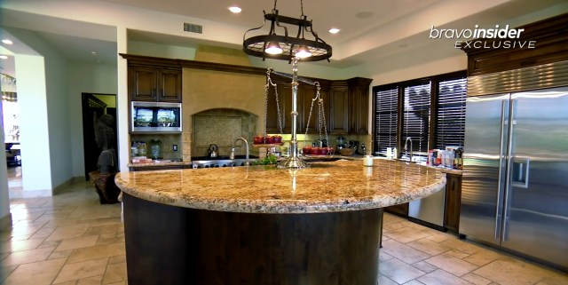 The kitchen features a large island