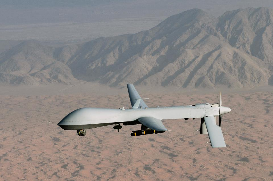 Countries such as China are investing in drone technology. Pictured: A Predator drone flying over a desert carrying missiles