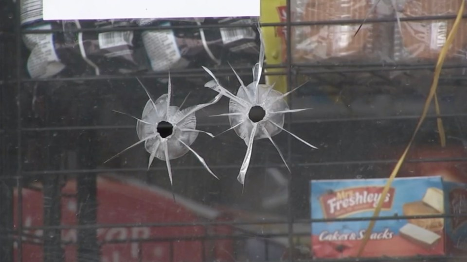 Bullet holes can be seen in the store