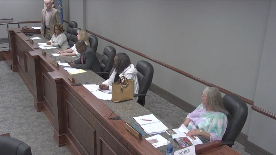 Seated three chairs away, Councilwoman Freeman could be seen heavily breathing and weeping, while her hands cradlde her masked face