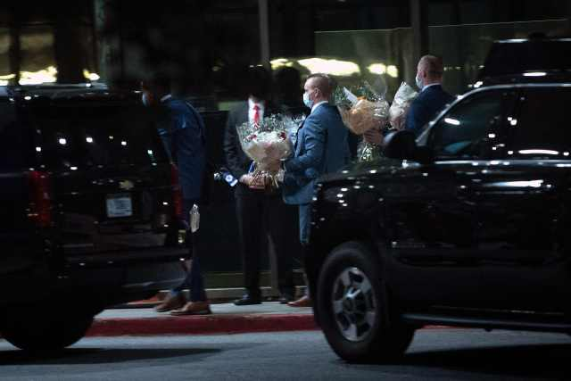 The couple were photographed arriving with gift baskets and flower bouquets to the Bethesda, Maryland military hospital
