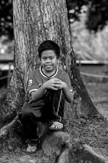 Mohd Mansyah Kusumah's son posing for his portrait.