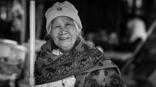 luang prabang smiling woman street portrait