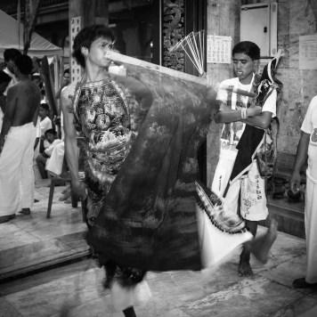 man flag waving dancing trance phuket vegetarian festival