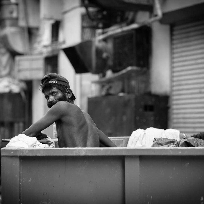 street portrait man rubbish skip collecting trash