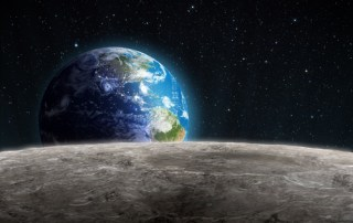 Planet Earth rises up over the Moon's horizon
