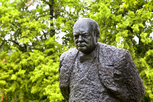 Winston Churchill statue against a background of trees