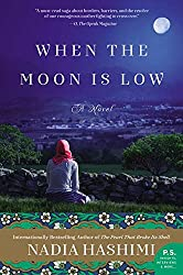 When the moon is low -- book cover with a woman facing away