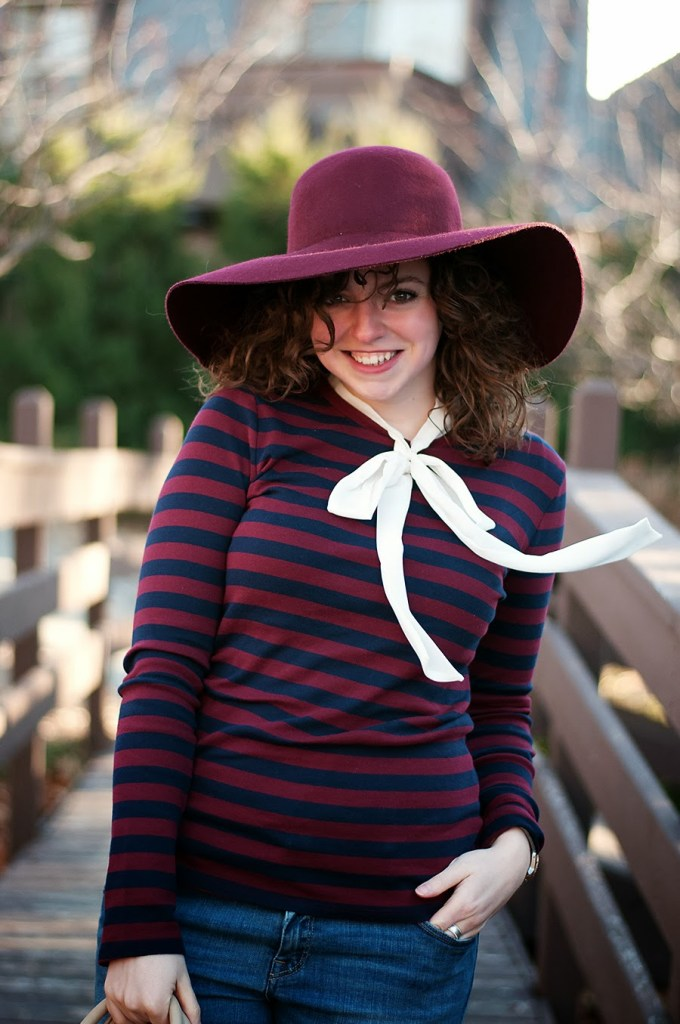 Striped shirt with a pussy bow and large hat