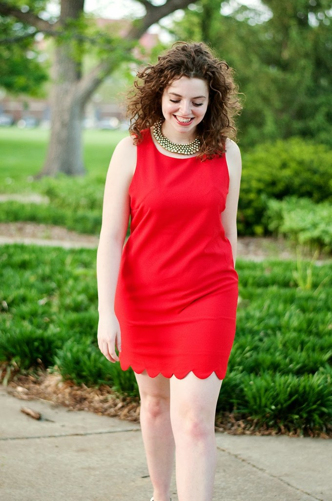 Red scallop dress with black and white heels