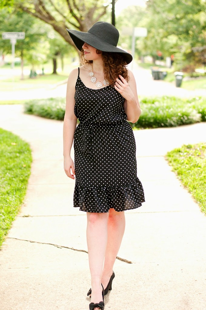 Polka dot summer dress with a black floppy hat.