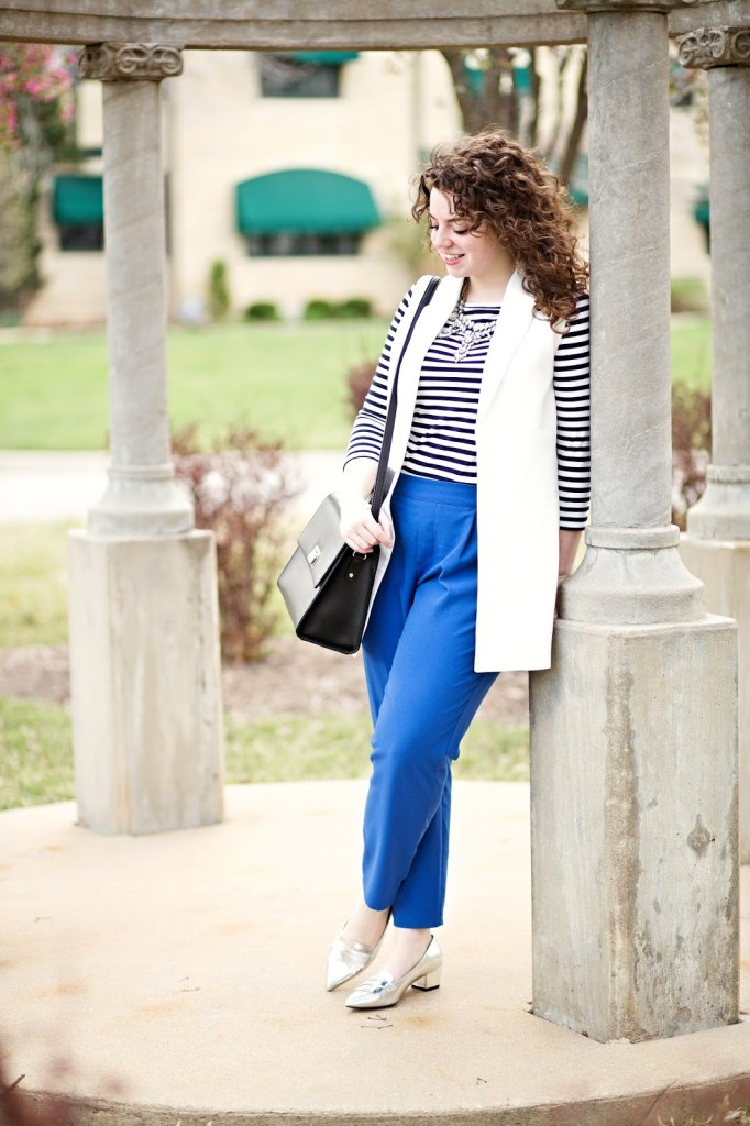 Classics don't have to be boring! Alissa wore a white sleeveless trench with crepe pants for a fun look that reminds us of spring!