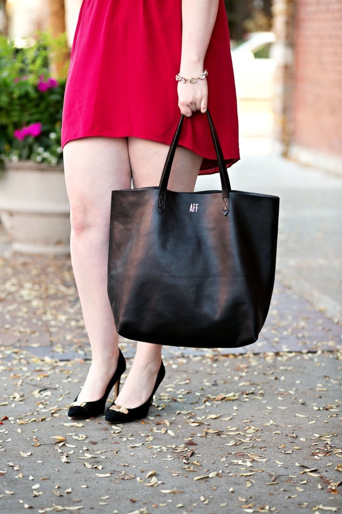 Madwell fable red silk dress with heels and Madewell transport tote bag.
