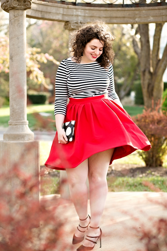 A classic black and white outfit with a fun skirt that makes a fun and flirty look!