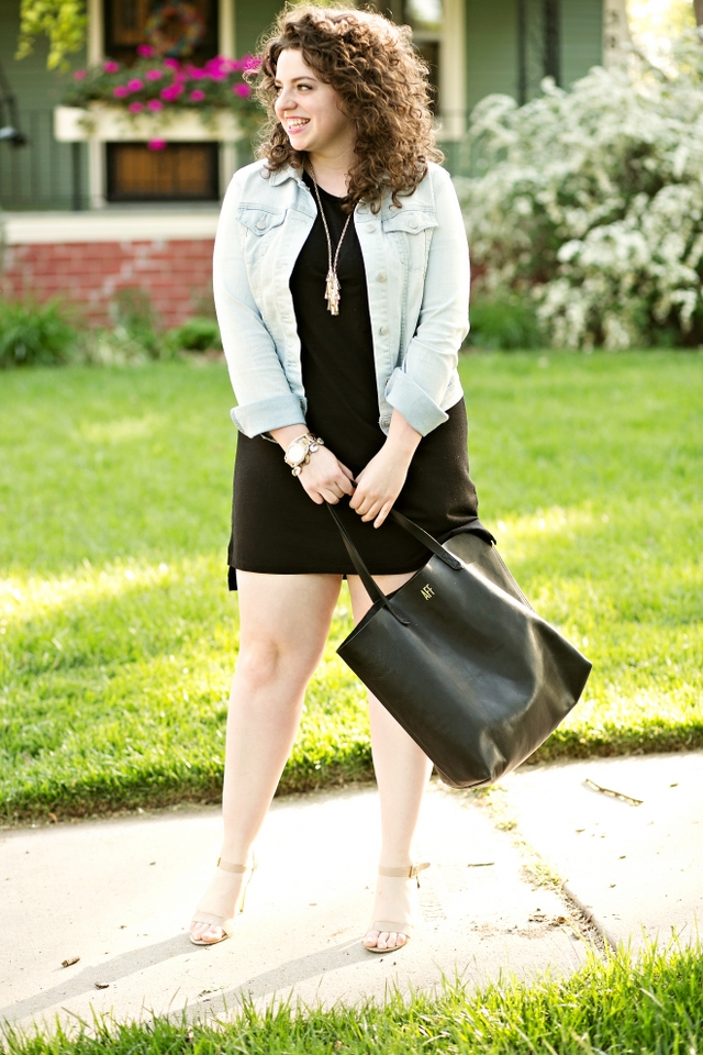 A simple black dress for the spring is perfect with a Madewell tote bag that makes for an easy spring outfit,