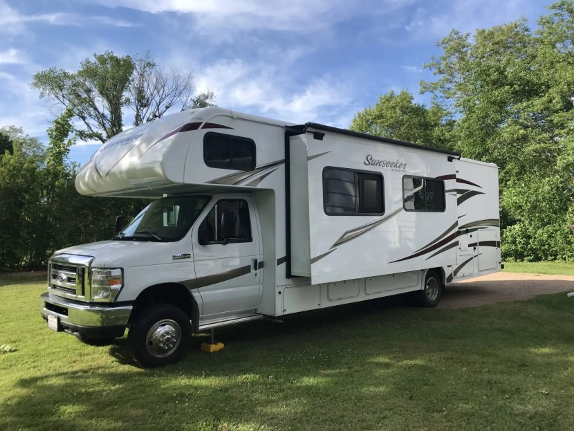 The Adventure Travelers RV in grass