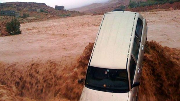 Powerful surge: A car is carried away by flood waters in the southern region of  Ouarzazate in Morocco.