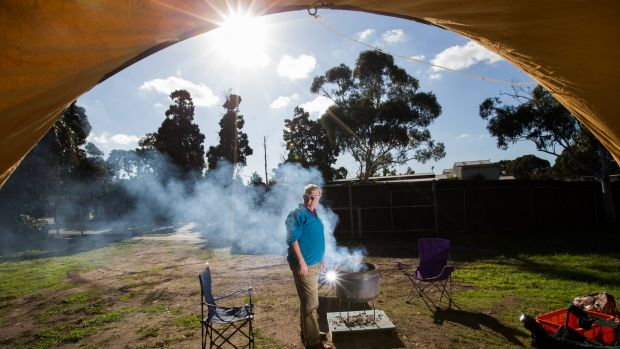 Councillor Jim Magee at his Caulfield Racecourse camp site.