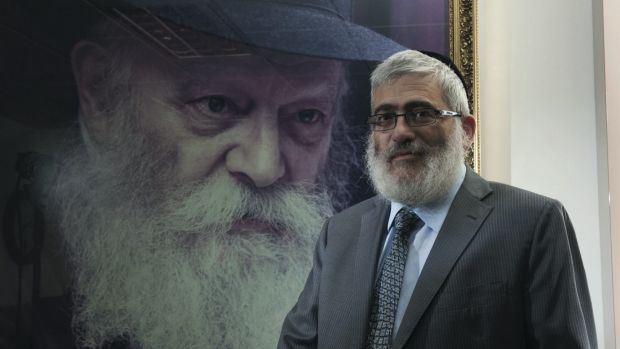 'Diamond Joe' Gutnick in front of a painting of Rabbi Menachem Mendel Schneerson, the last Lubavitcher Rebbe.