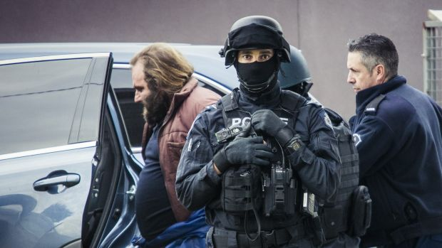 Phillip Galea is led from a house by police during a terror raid in Braybrook.