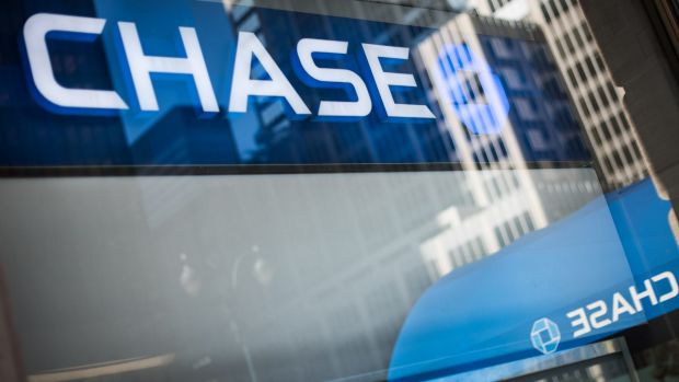 Signage is reflected in the window of a JPMorgan Chase & Co bank branch in New York.