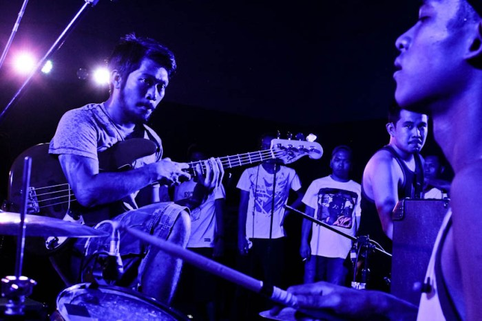 Embercore bassist Caloy Monasteryo looks at drummer Lester Faraon as they start a song during their 8th anniversary gig at Southrock Skatepark in Calamba, Laguna. Photo by: Chris Quintana