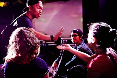 Moy Lapiz (left), vocalist of metalcore band Last Action Heroes, greets friends at a gig in the band's hometown of Los Baños, Laguna. (Photo by: Chris Quintana)