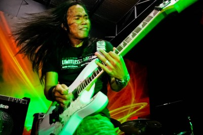 Ralph Morales, guitarist of Calapan, Mindoro-based metal band Untold, performs during a gig in Los Baños, Laguna. (Photo by: Chris Quintana)