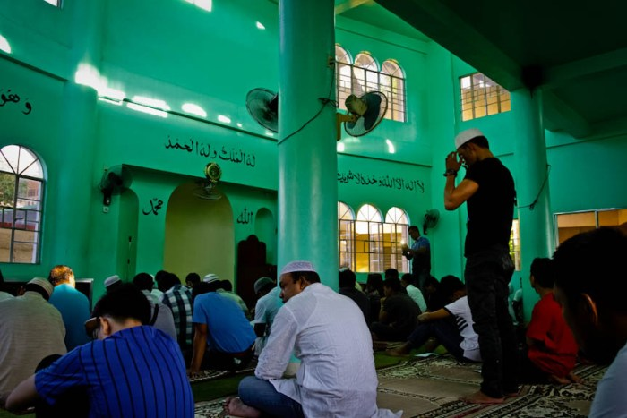 A Muslim man performs the salah before the start of the prayer inside the mosque during Eid al-Adha in Los Baños, Laguna. Photo by: Chris Quintana.