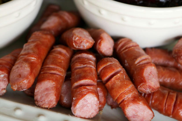 A Halloween appetizer featuring lil' smokies cut to look like fingers and a trio of frightening dipping sauces.