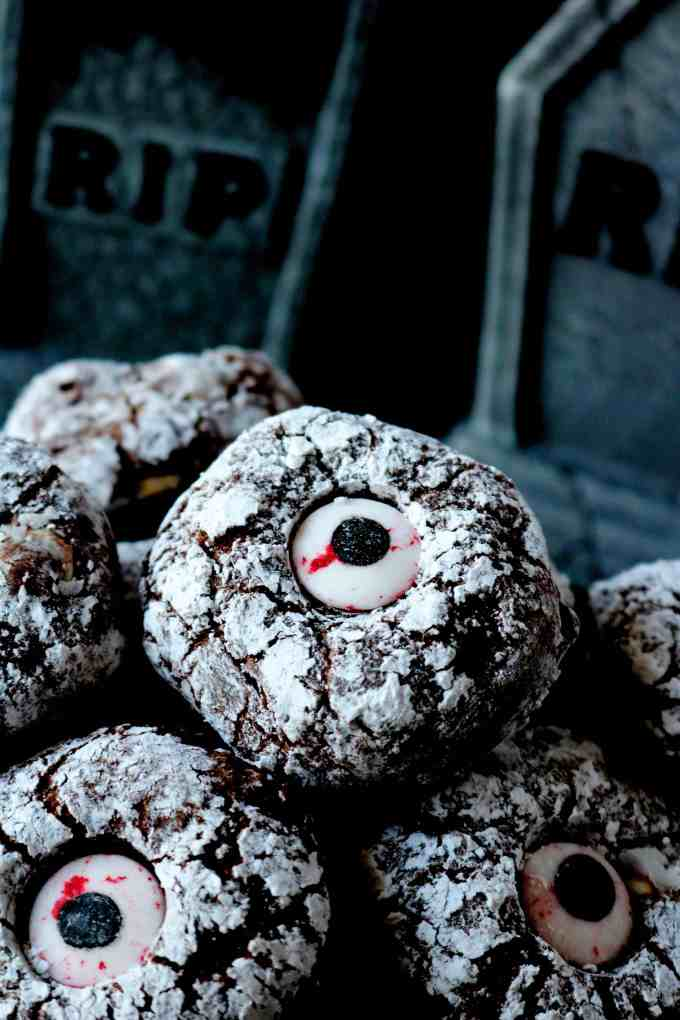 A Halloween cookie, featuring an easy and deliciouschocolate cookie withpowdered sugar and candy eyes.