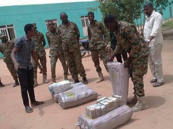 Latest International News : $130m stuffed in rice bags found in Sudan Bashir's house