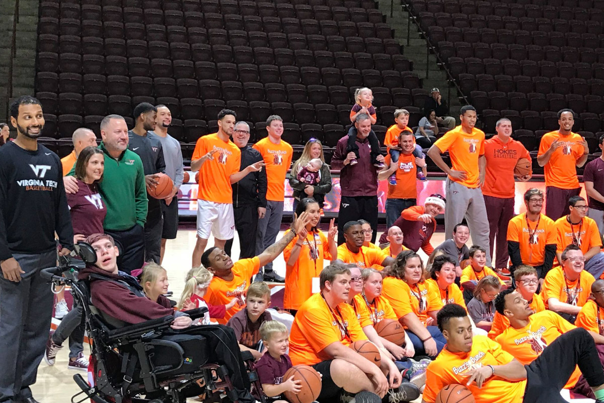Special Olympics particpants gathered in the gym in Roanoke for a group photo