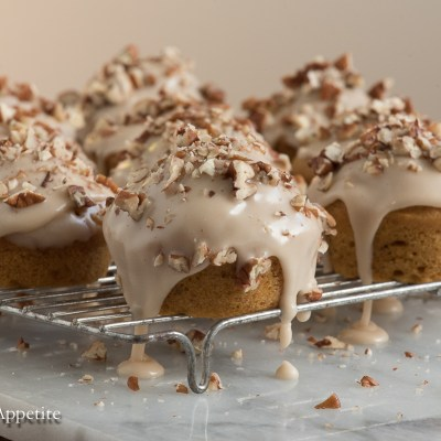 These Vegan Pumpkin Spice Muffins with Maple Icing and Pecans is easy to throw together. The perfect addition to a Thanksgiving breakfast! From The Artful Appetite