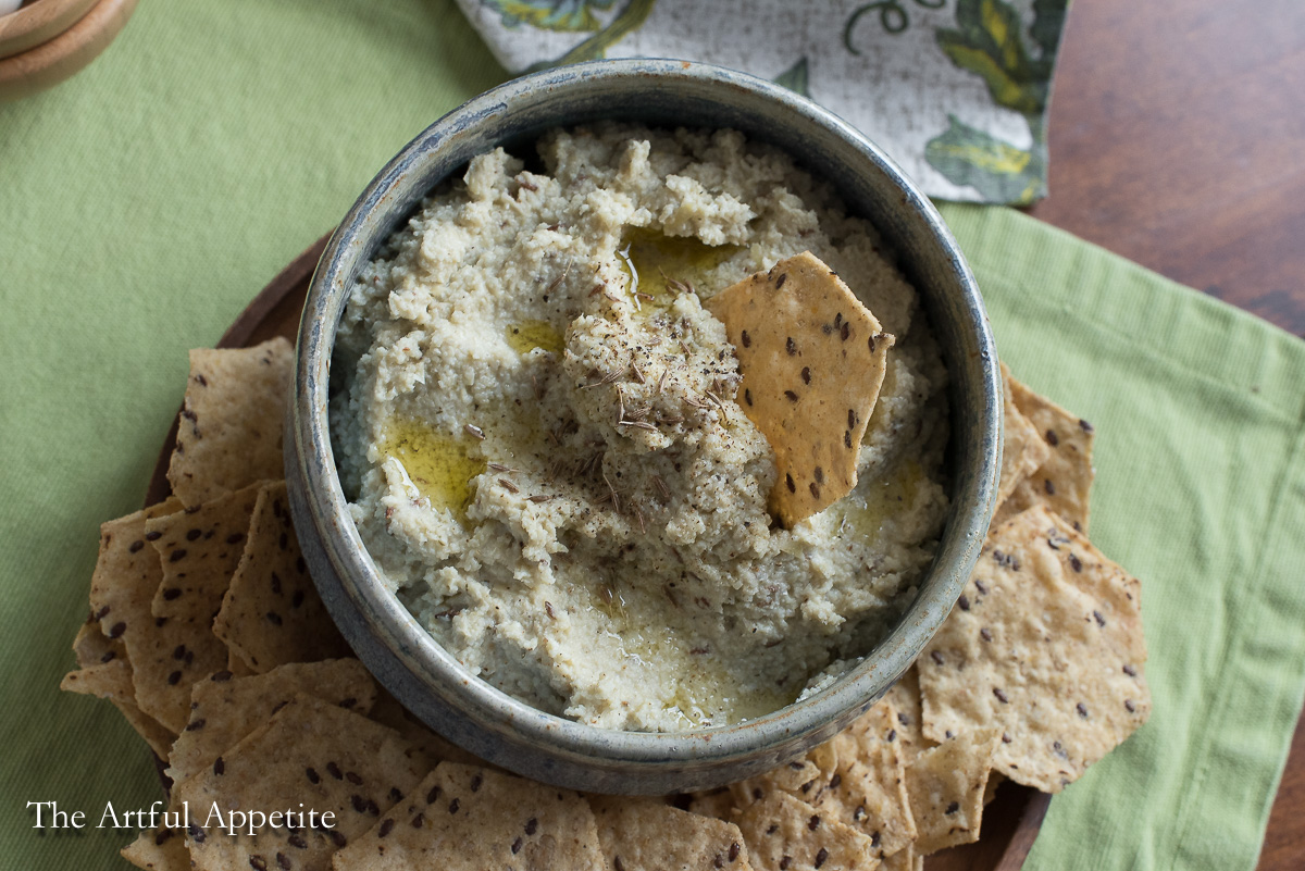 A simple dip perfect for game day! Healthy Artichoke Cumin Garlic Dip is vegan and delicious.
