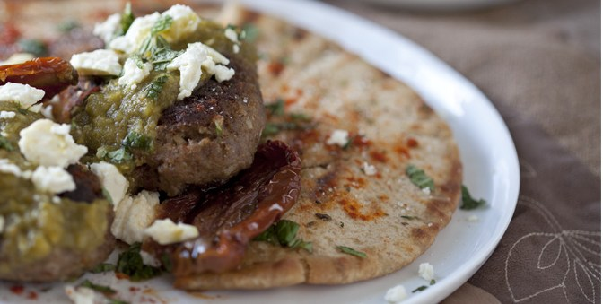 Spiced Moroccan Burgers with Green Harissa, Feta and Mint over Grilled Pita