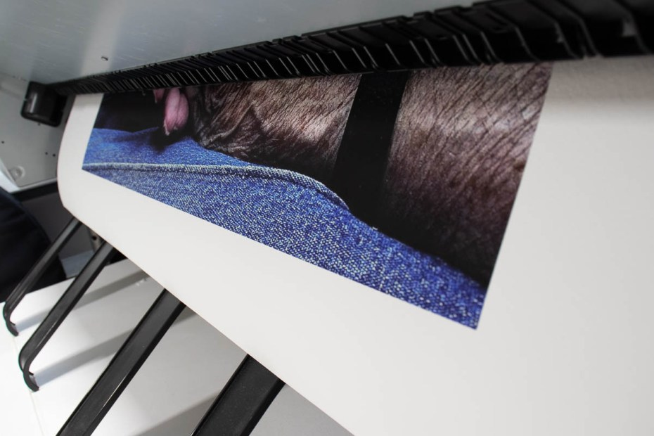 Fine art print coming out of a printer