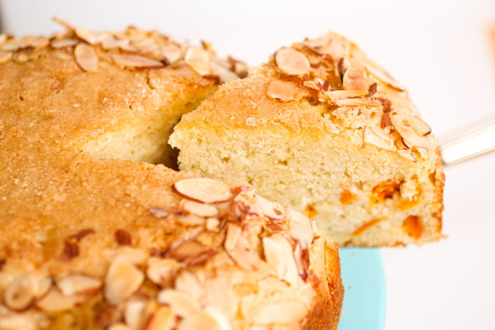 Inside view of apricot almond cake studded with fruit