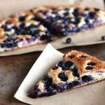 Grape Focaccia - Schiacciata con l'uva: A sweet wine harvest flatbread from Tuscany made with layers of bread dough filled and topped with wine harvest grapes and sugar. When baked, the grapes and sugar meld together to create a jammy center with crunchy seeds. Simply deliziosa!